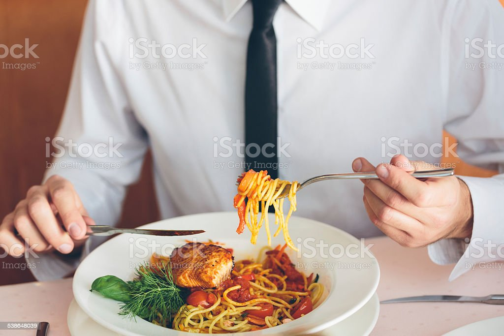 Businessman on lunch Businessman eating pasta. Close up of meal. Unrecognizable person. 2015 Stock Photo