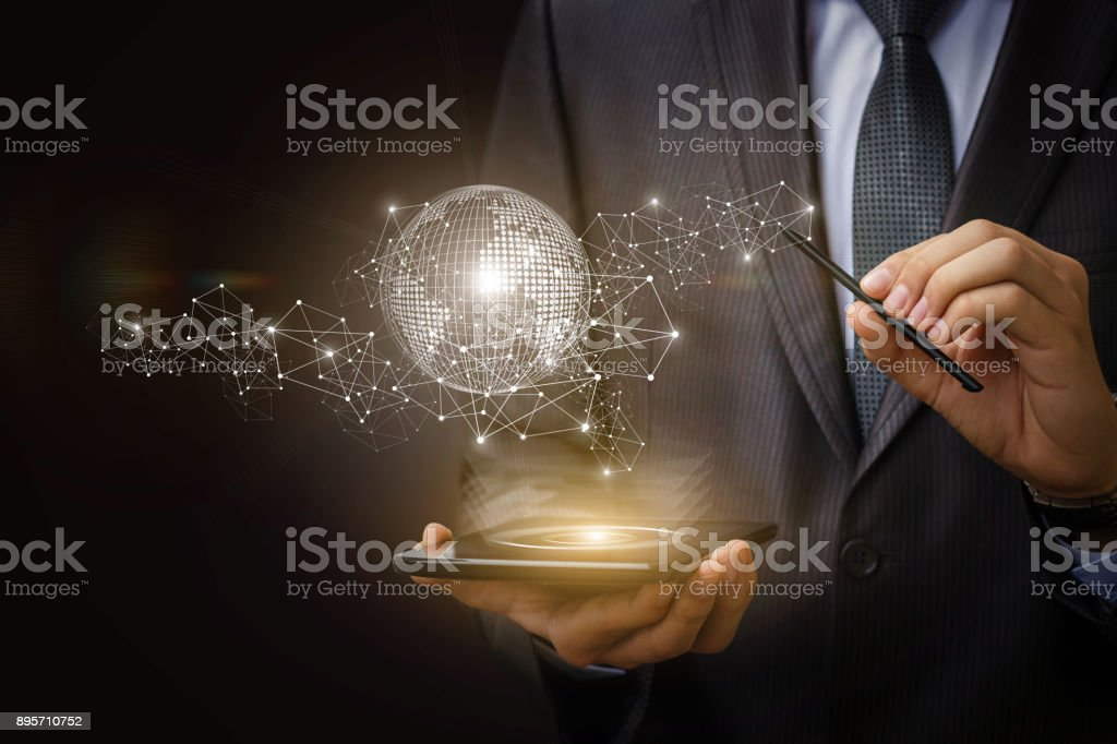 Businessman on mobile computer works on the network. stock photo
