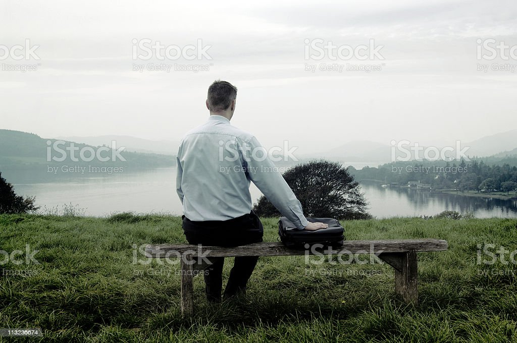 businessman on park bench with laptop case royalty-free stock photo