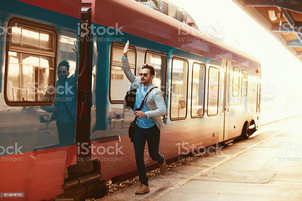 Businessman on railroad station stock photo