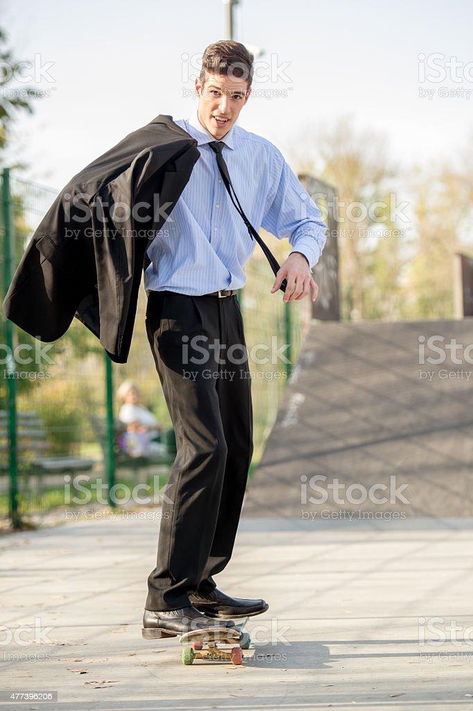 Businessman On Skateboard stock photo