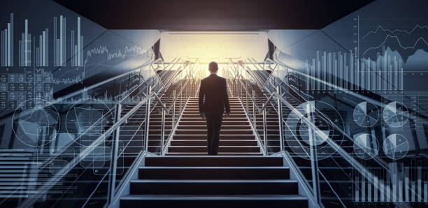 Businessman on staircase low angle view. stock photo