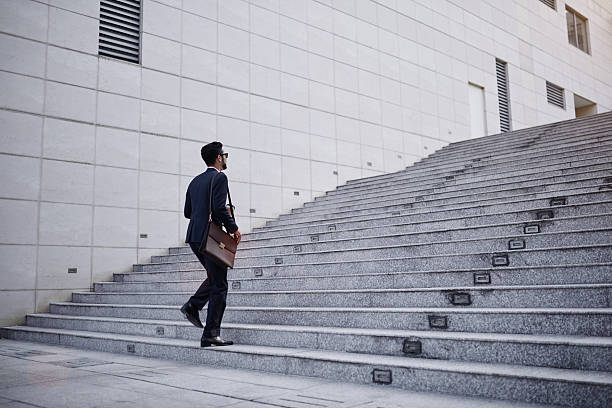 businessman on stairs - staircase stock photos and pictures