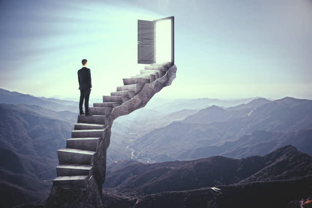 Businessman on stairs with door Businessman standing on stairs with abstract open door. Landscape background. Dream, exit and success concept. 3D Rendering doorway stock pictures, royalty-free photos & images