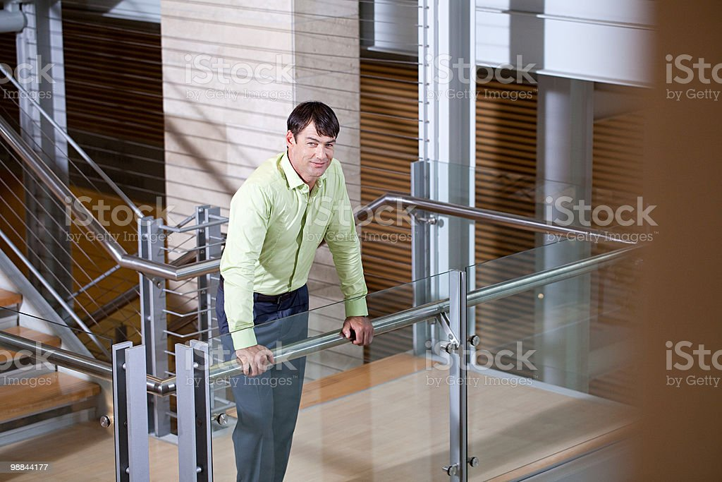 Businessman on stairwell royalty free stockfoto