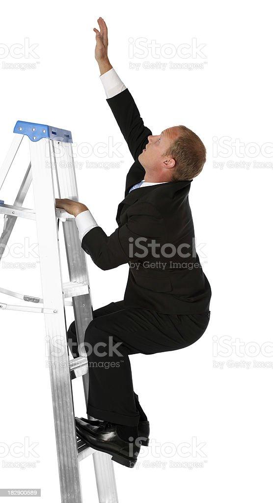 Businessman on step ladder royalty-free stock photo