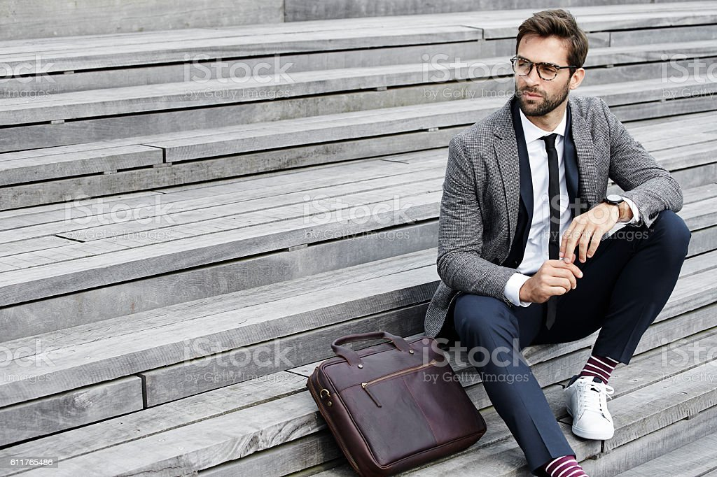 Businessman on steps - Photo