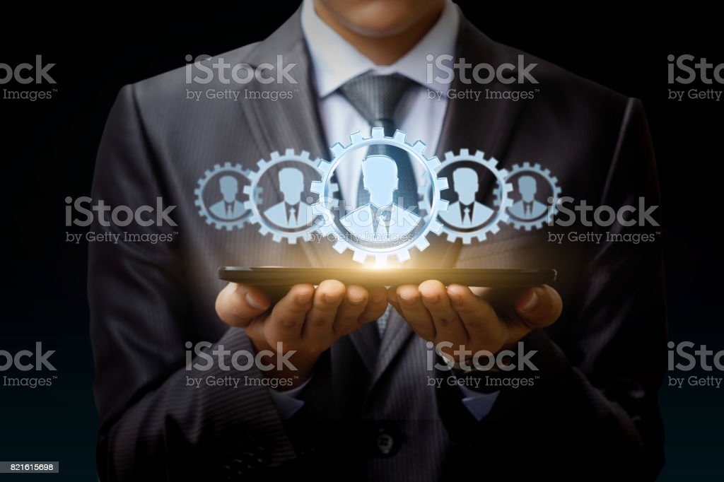 Businessman on tablet represents a team of Customers . stock photo