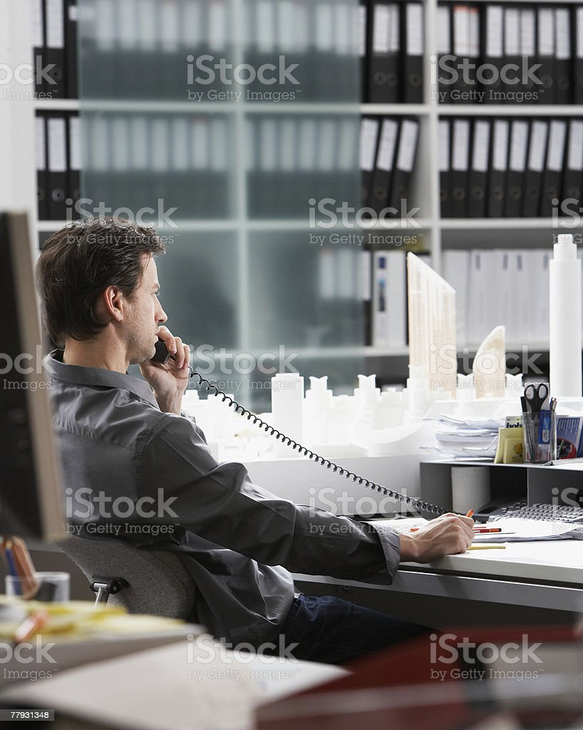 Businessman on telephone at desk in office royalty-free stock photo