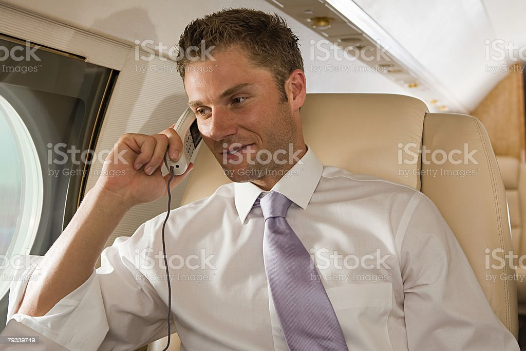 Businessman on telephone in jet royalty-free 스톡 사진