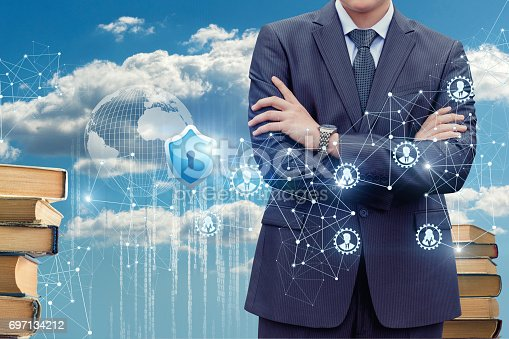 1156072209istockphoto Businessman on the background of the protected cloud data . 697134212