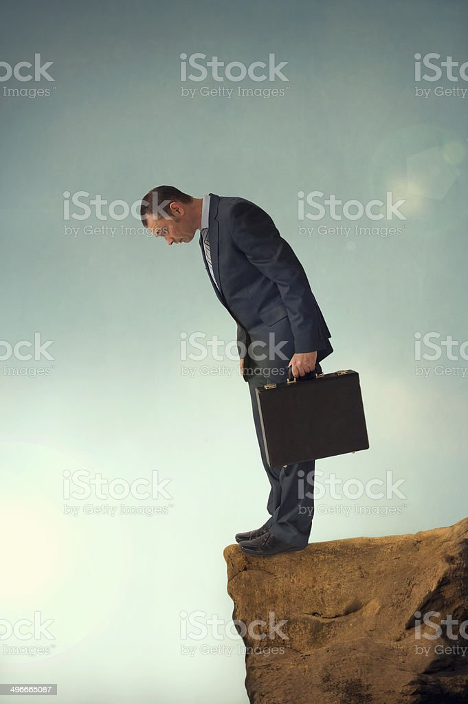 businessman on the brink stock photo