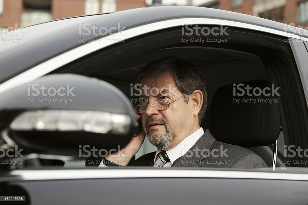 Businessman on the Car Telephone stock photo