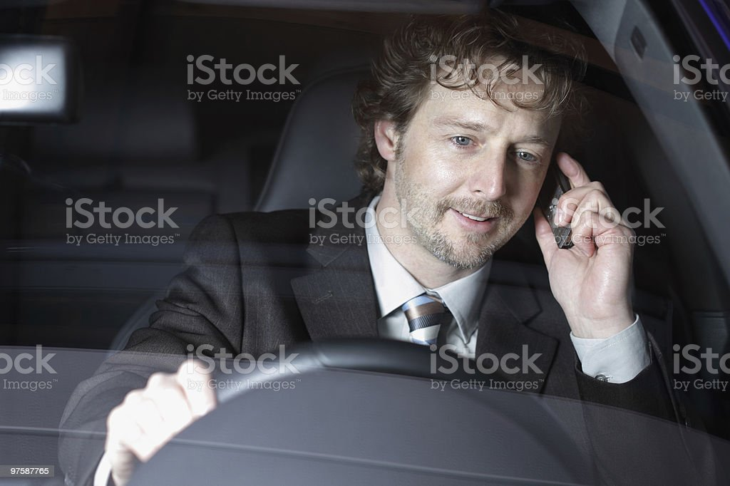 Businessman on the phone in his car royalty-free stock photo