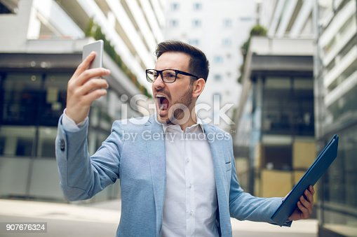 istock Businessman on the phone shouting 907676324