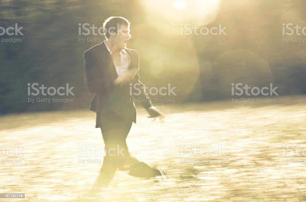 Businessman on the run stock photo