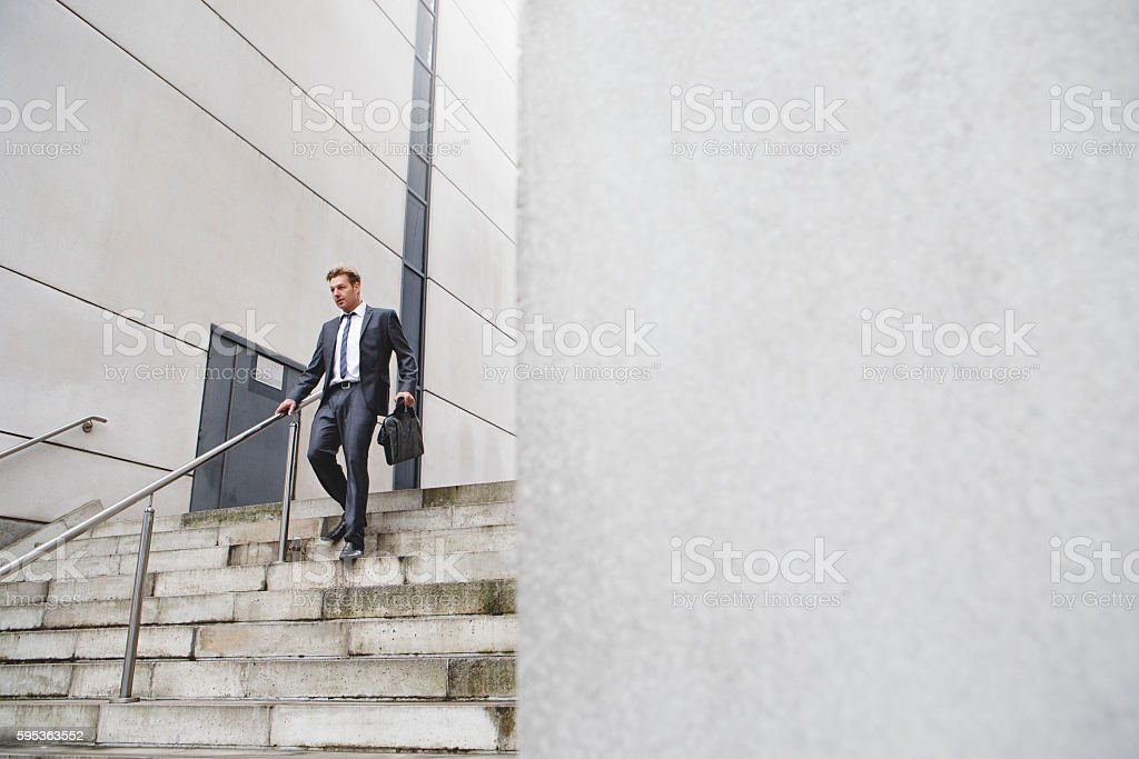 Businessman on the stairs stock photo
