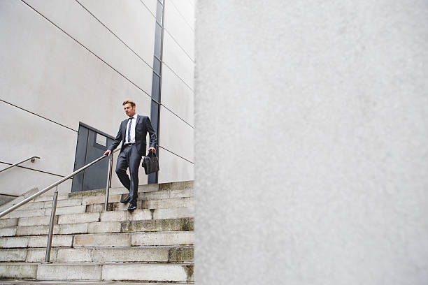 businessman on the stairs - after work stock photos and pictures