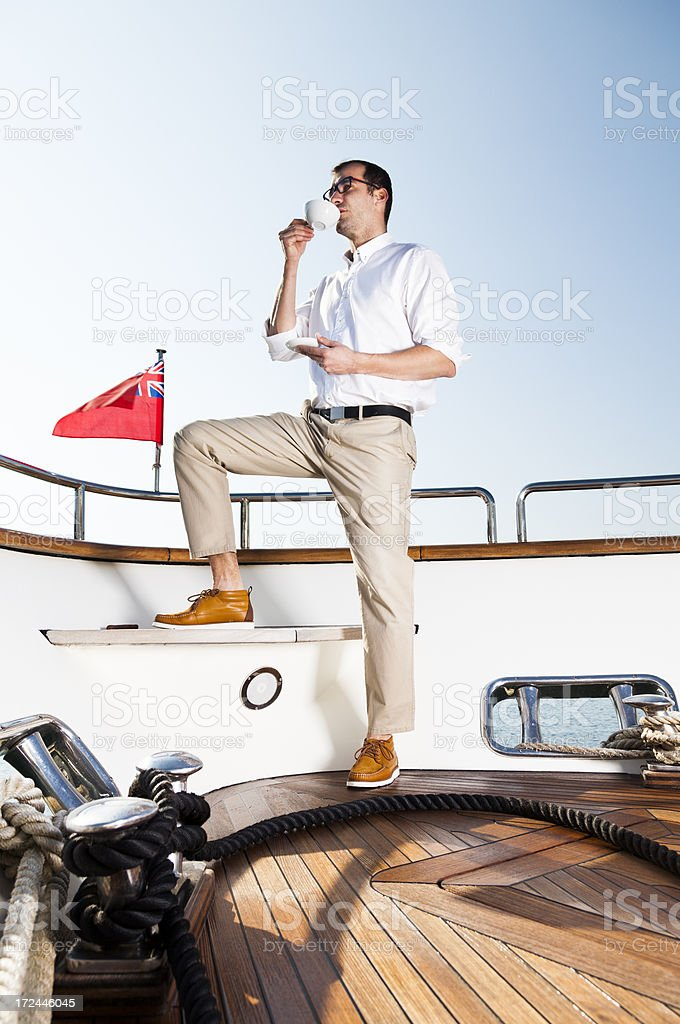 Businessman on the Yacht. Relaxing. Drinking Coffee. royalty-free stock photo