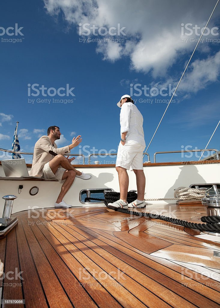 Businessman on the yachts royalty-free stock photo