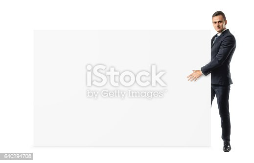 istock Businessman on white background is holding a shoulder-height blank 640294708