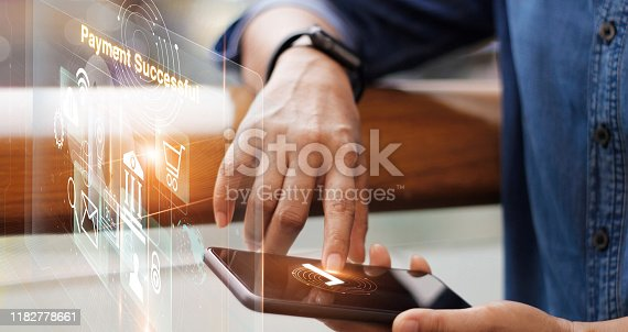 istock Businessman online payment on smart phone on virtual interface, technology and innovative, banking and online shopping. 1182778661