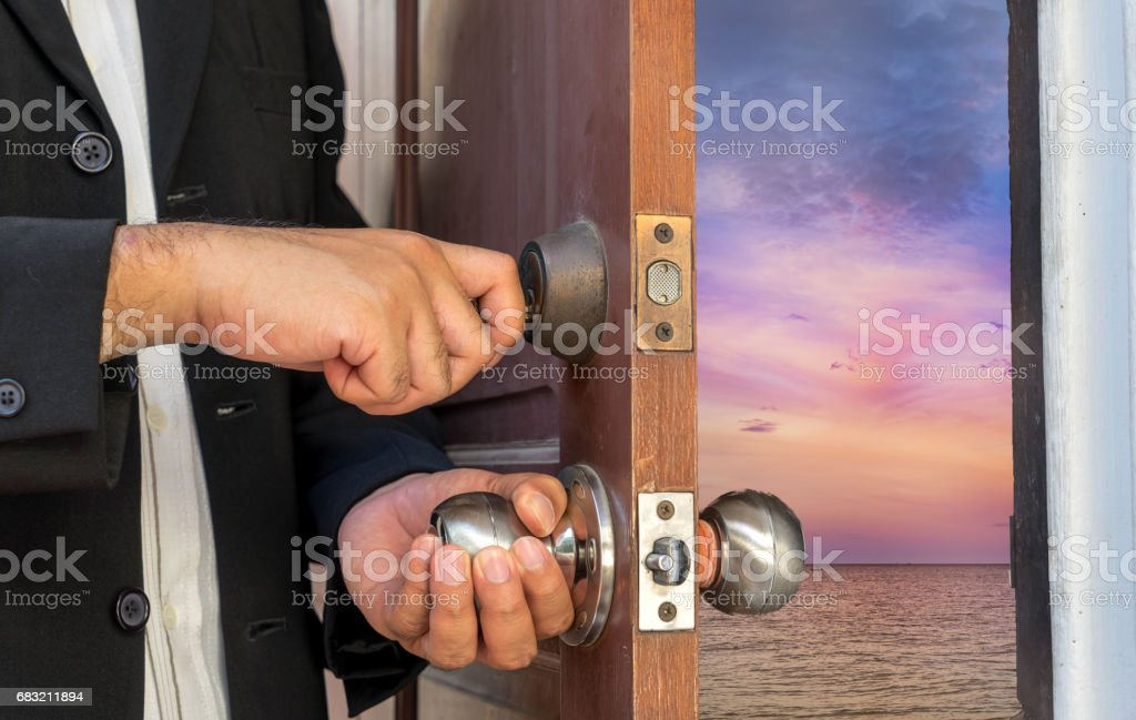 businessman open the door to sea sunset scene royalty-free 스톡 사진