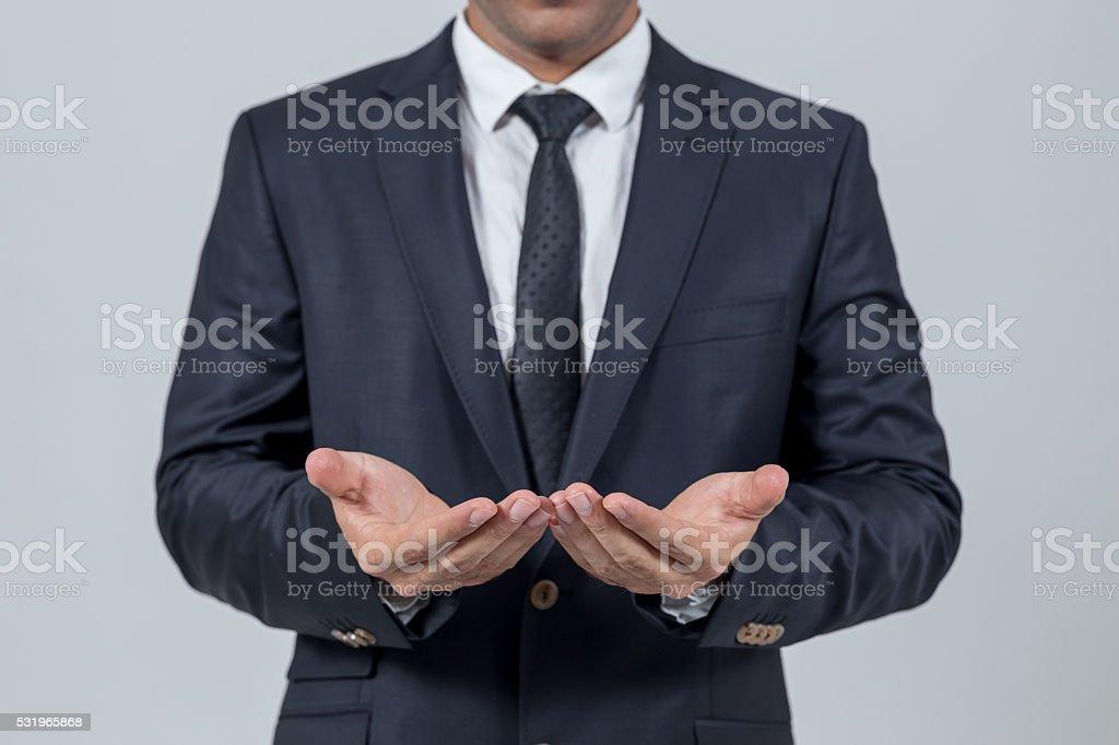 Businessman opening hands stock photo