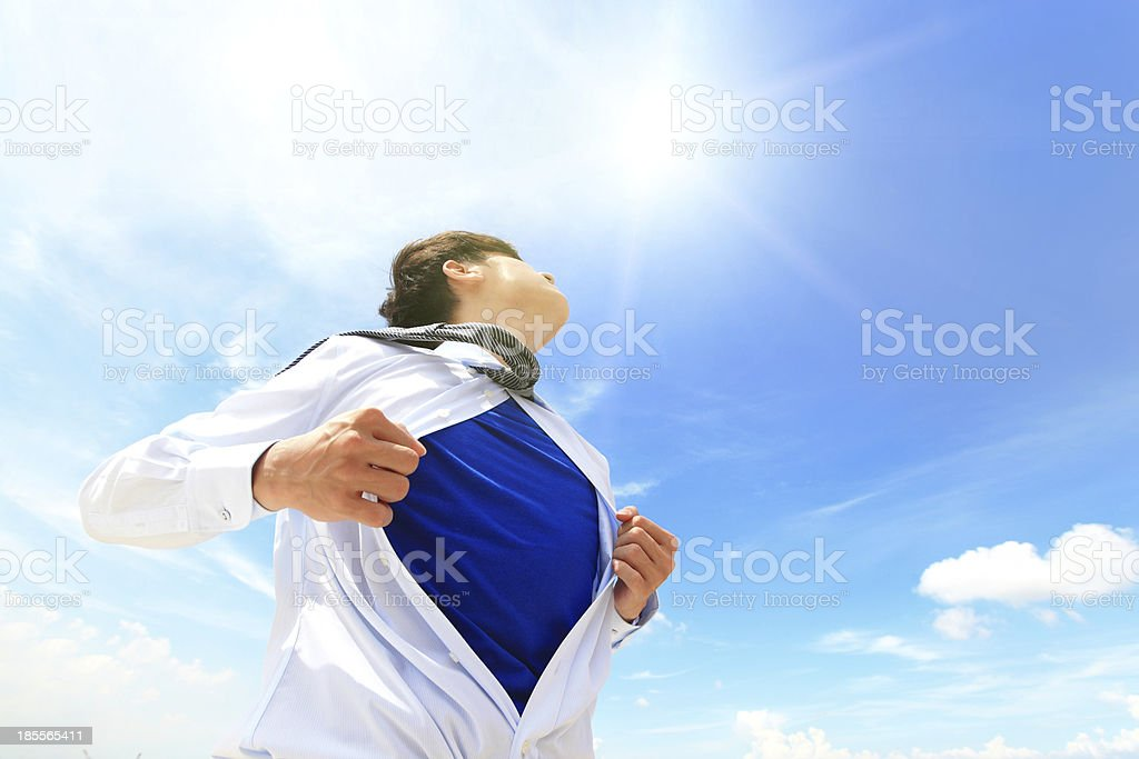 A businessman opening his shirt while looking at the sky royalty-free stock photo
