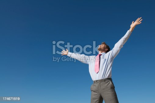 istock Businessman Opens Arms to Blue Sky for Inspiration 174671519