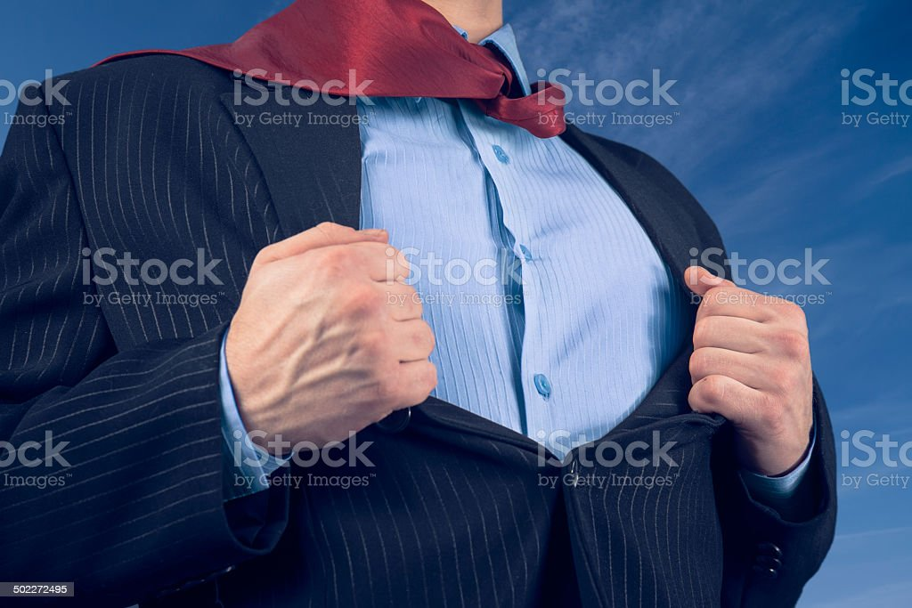 Businessman opens suit showing his shirt stock photo