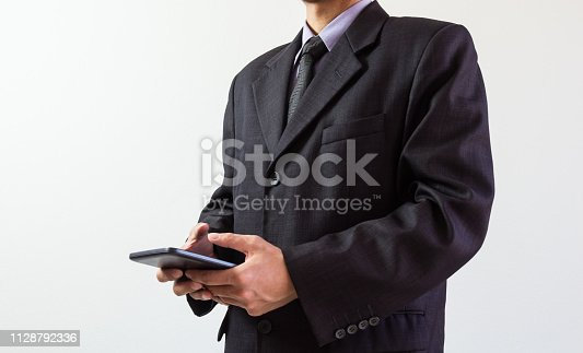 952991586istockphoto Businessman or accountant working on calculator to calculate business data concept. Accounting,investment advisor consulting situation on the financial report and planning a marketing plan at office. 1128792336