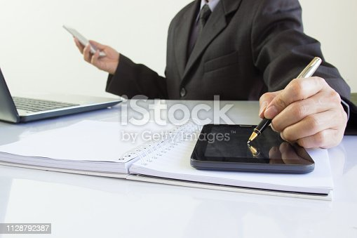 952991586istockphoto Businessman or accountant working on calculator to calculate business data concept. Accounting,investment advisor consulting situation on the financial report and planning a marketing plan at office. 1128792387
