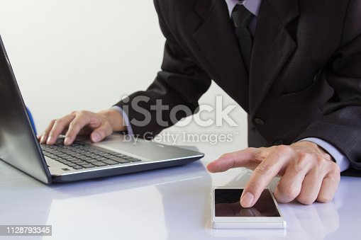 952991586istockphoto Businessman or accountant working on calculator to calculate business data concept. Accounting,investment advisor consulting situation on the financial report and planning a marketing plan at office. 1128793345