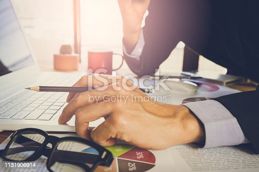 istock Businessman or accountant working on calculator to calculate business data concept. Accounting,investment advisor consulting situation on the financial report and planning a marketing plan at office. 1131906914