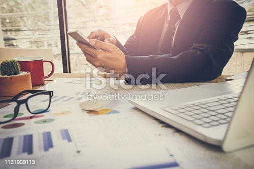 istock Businessman or accountant working on calculator to calculate business data concept. Accounting,investment advisor consulting situation on the financial report and planning a marketing plan at office. 1131909113