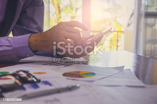 952991586istockphoto Businessman or accountant working on calculator to calculate business data concept. Accounting,investment advisor consulting situation on the financial report and planning a marketing plan at office. 1183252966