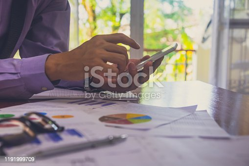 952991586istockphoto Businessman or accountant working on calculator to calculate business data concept. Accounting,investment advisor consulting situation on the financial report and planning a marketing plan at office. 1191999709
