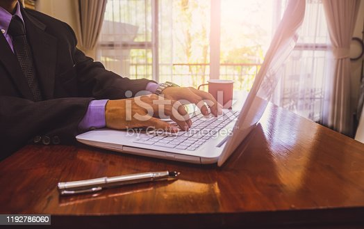 952991586istockphoto Businessman or accountant working on calculator to calculate business data concept. Accounting,investment advisor consulting situation on the financial report and planning a marketing plan at office. 1192786060