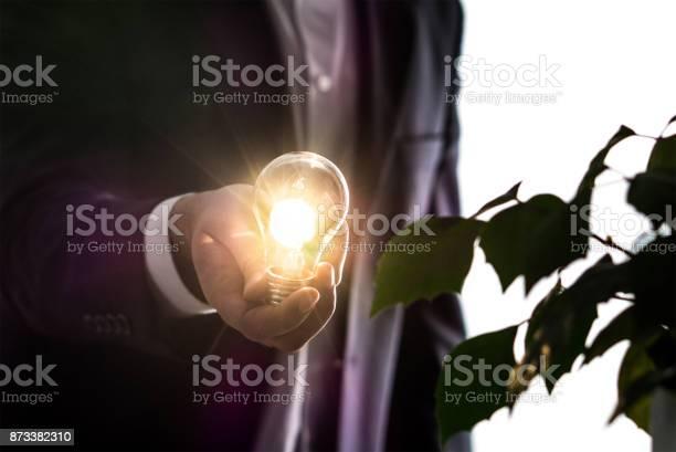 Businessman Or Man In A Suit Holding An Illuminated Light Bulb In Hand - Fotografie stock e altre immagini di Adulto