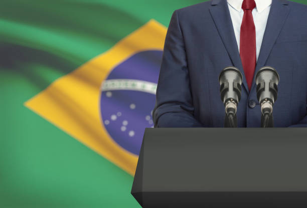 businessman or politician making speech from behind a pulpit with national flag on background - brazil - 政治家 ストックフォトと画像