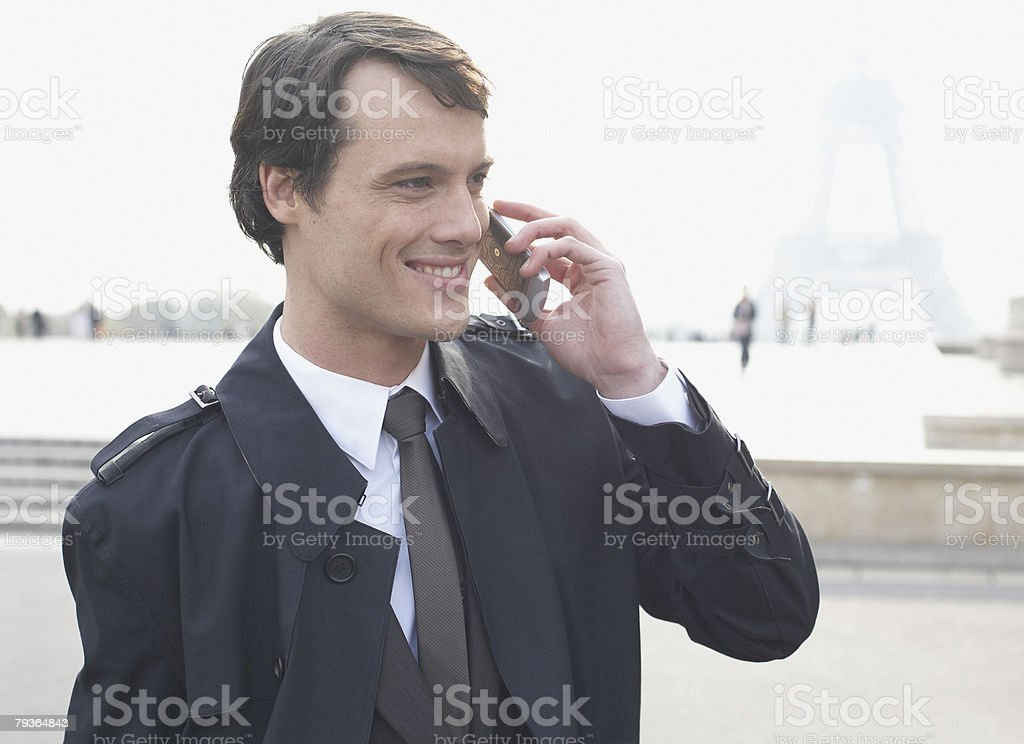 Businessman outdoor on cellular phone by Eiffel Tower 免版稅 stock photo