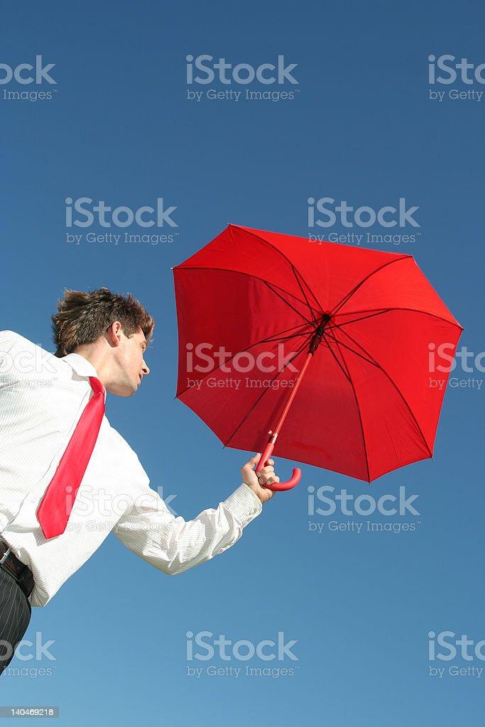 Businessman Outdoors Holding an Umbrella royalty-free stock photo