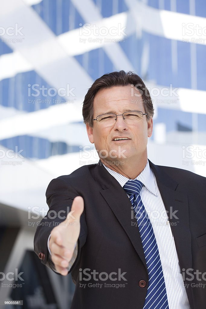 Businessman Outdoors Holds Out His Hand To Shake royalty-free stock photo