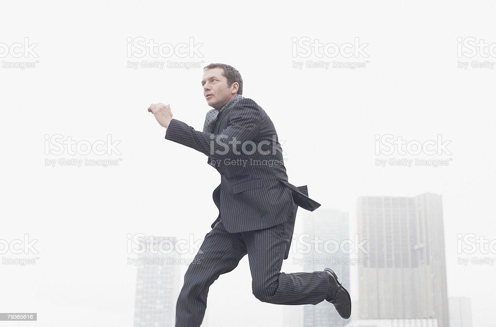 Businessman outdoors jumping stock photo