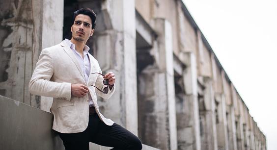 Attractive man standing outdoors
