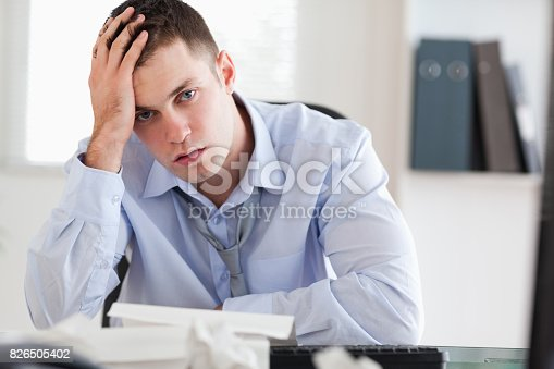 690496350istockphoto Businessman overextended with his accounting 826505402