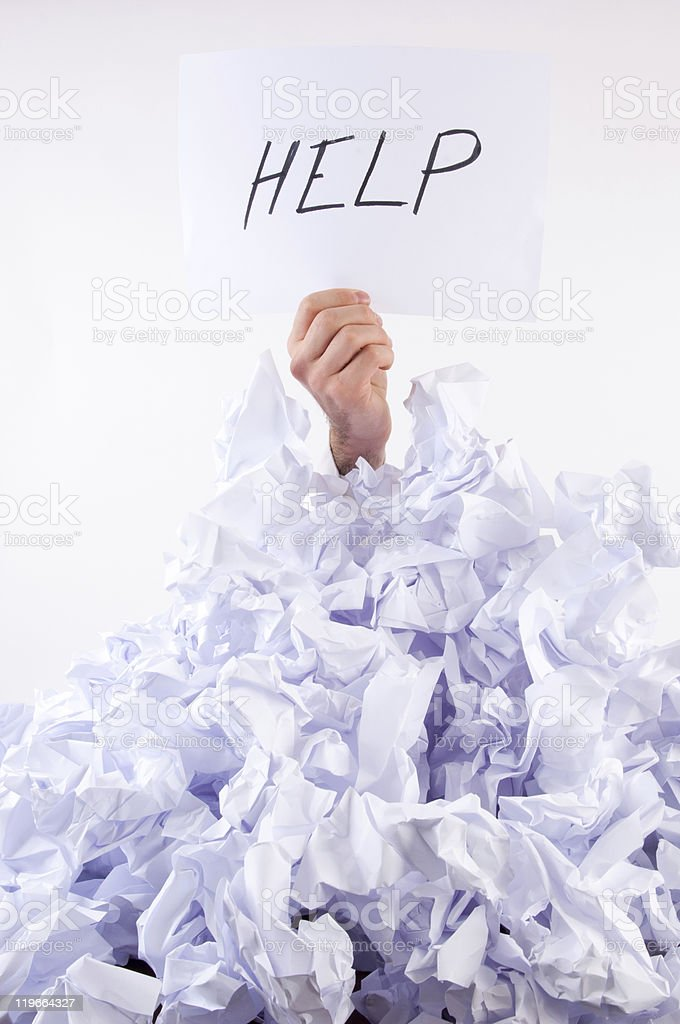 Businessman overwhelmed by paper royalty-free stock photo