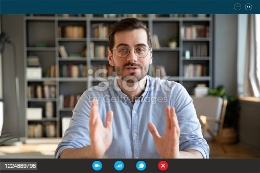 Businessman participate at virtual distant negotiations with colleagues via teleconference. Talk with clients provide information strategizing remotely. Video call self-isolation during ncov situation