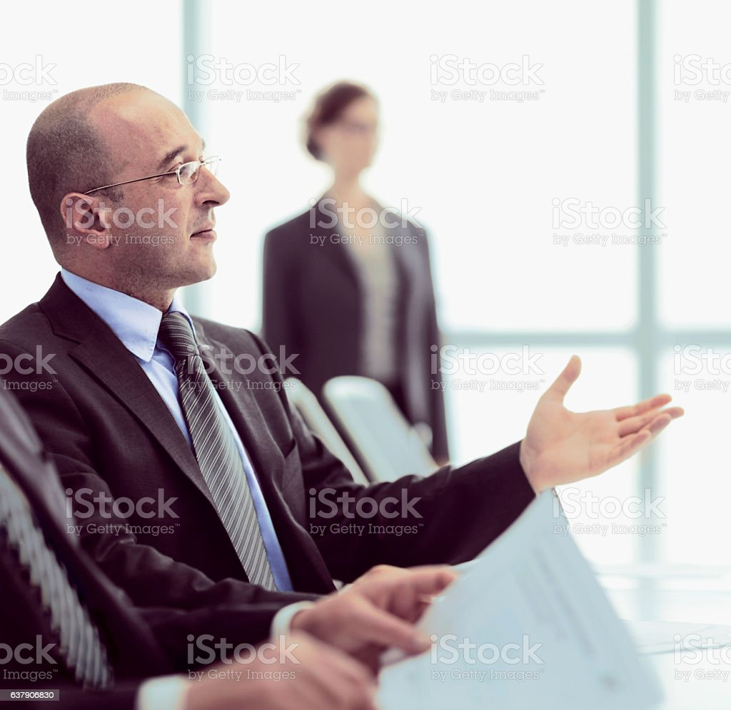 Businessman participating in office meeting stock photo